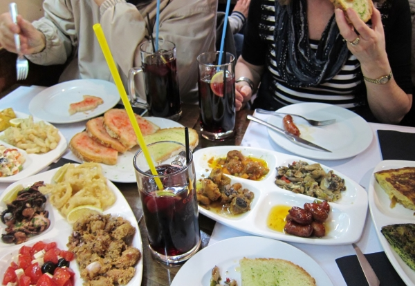 Tapas - Notice the Octopus on the left and the enormous glasses of sangria complete with the longest straw in the world